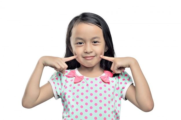 Portrait, de, petite fille asiatique, à, doigts, joue