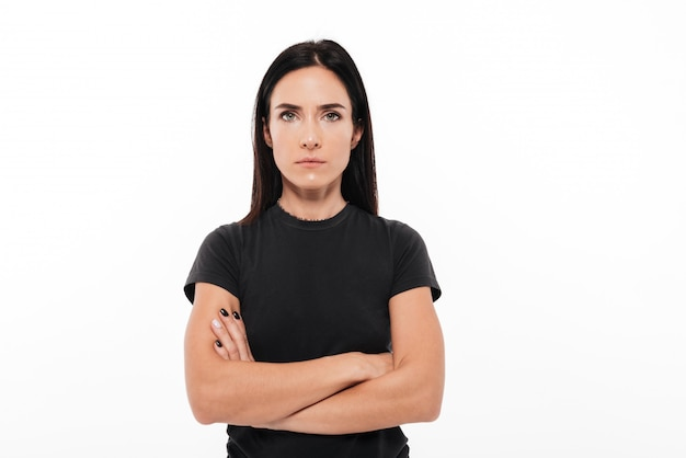 Portrait, sérieux, femme, debout, bras, plié