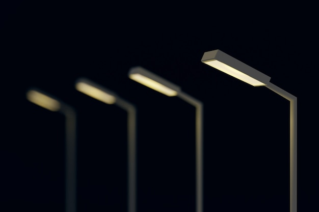 Poste de réverbère dans la scène sombre de la nuit.