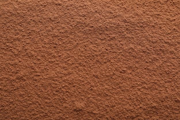 Poudre de cacao texturée, gros plan et espace pour le texte