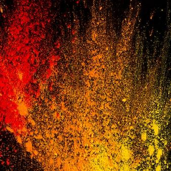 Poudre colorée abstraite éclaboussée sur le fond