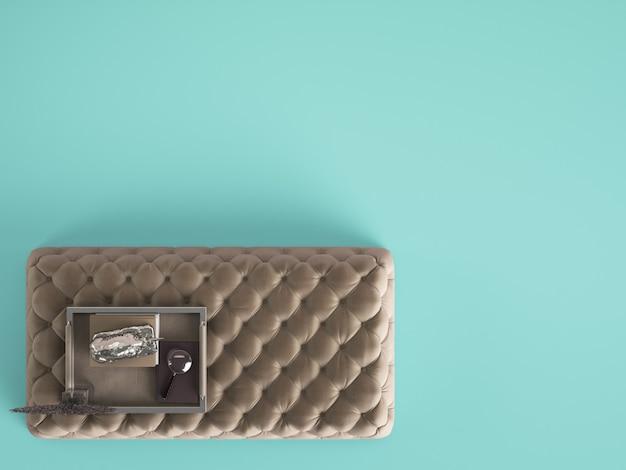 Pouf de table basse capitonné classique avec un décor de couleur bleu pastel avec espace copie. mise à plat