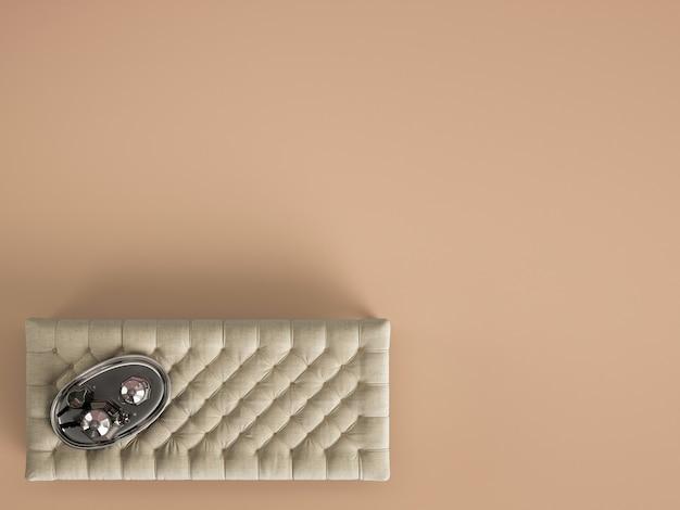 Pouf de table basse classique capitonné avec un décor de couleur ocre pastel avec espace copie. mise à plat