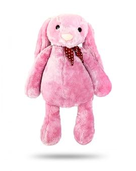Poupée lapin rose à grandes oreilles isolé sur fond blanc
