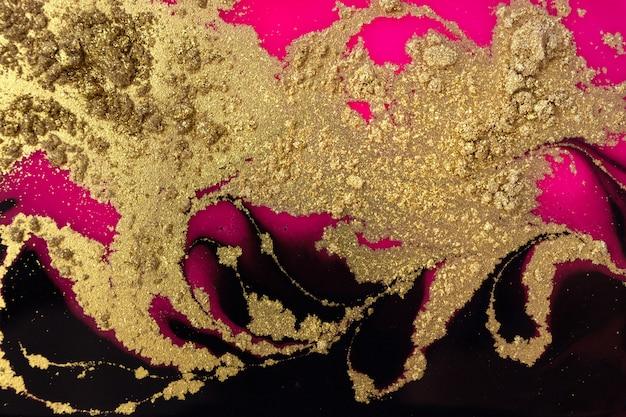 Poussière dorée, fond noir et rose. texture or mousseux.