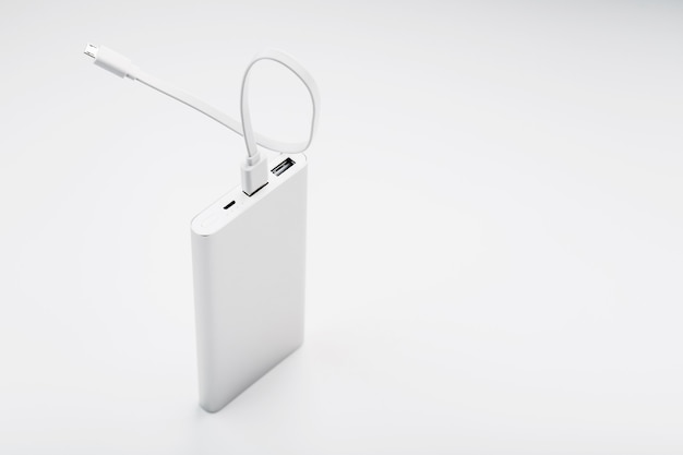Power bank pour charger votre smartphone sur une surface blanche