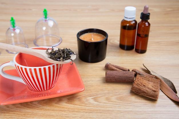 Préparation au thé zen avec massage aux chandelles et à la ventouse aux huiles essentielles