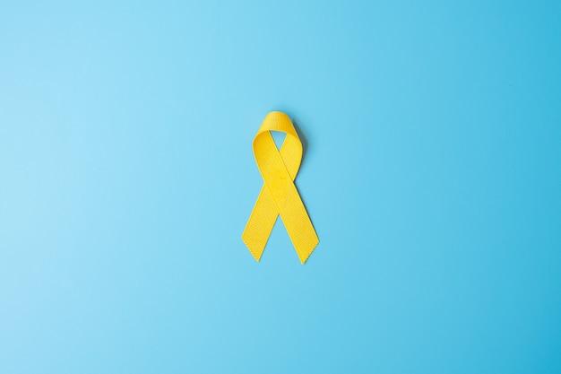Prévention du suicide, sarcome, os, vessie, mois de sensibilisation au cancer infantile, ruban jaune pour soutenir les personnes vivant et malades. enfants soins de santé et concept de journée mondiale du cancer