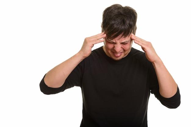 Prise de vue en studio d'un homme de race blanche ayant des maux de tête
