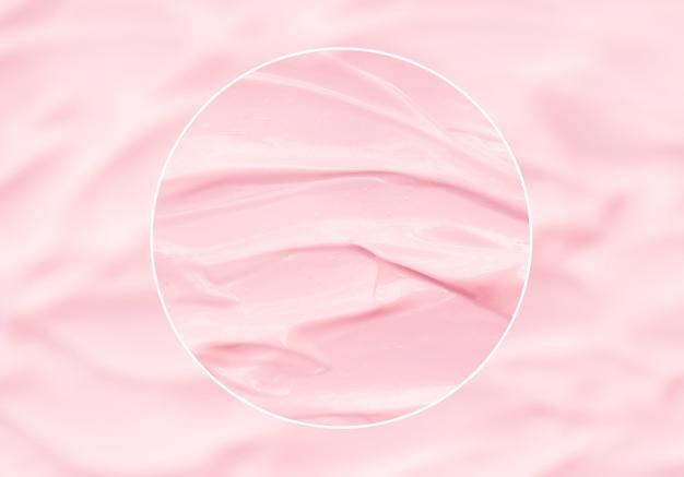 Produit cosmétique de soin de peau de lotion rose avec examen de crème de beauté de qualité de zoom de cercle