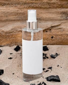 Produit de soin de la peau dans le sable