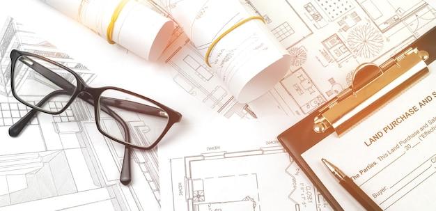 Projet d'esquisse d'architecte sur le plan des travaux de construction du site, photo d'arrière-plan