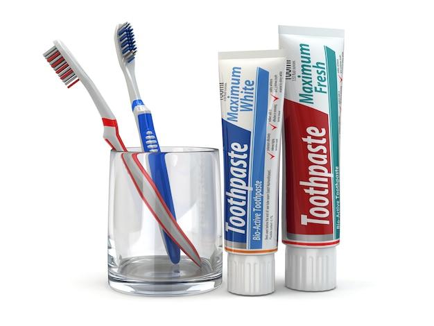 Protection dentaire, dentifrice et brosses à dents sur fond isolé blanc. 3d