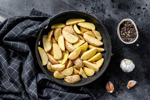 Quartiers de pommes de terre frites surgelés