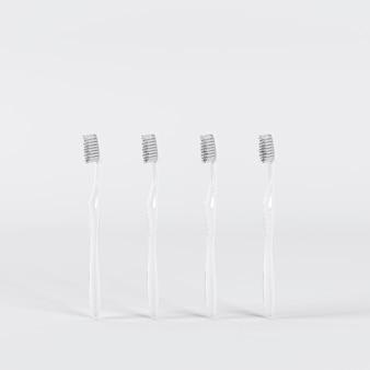 Quatre brosses à dents blanches debout