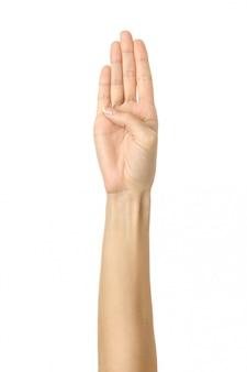 Quatre doigts croisés. main de femme gesticulant isolé sur blanc