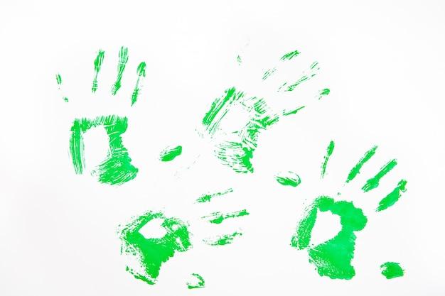 Quatre empreintes de mains vertes