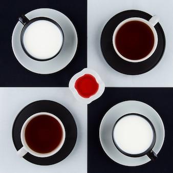 Quatre tasses de boissons, carré et confiture de framboises