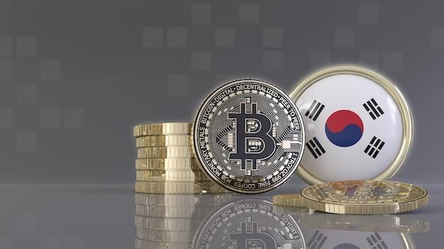 Quelques bitcoins métalliques devant un badge avec le drapeau sud-coréen
