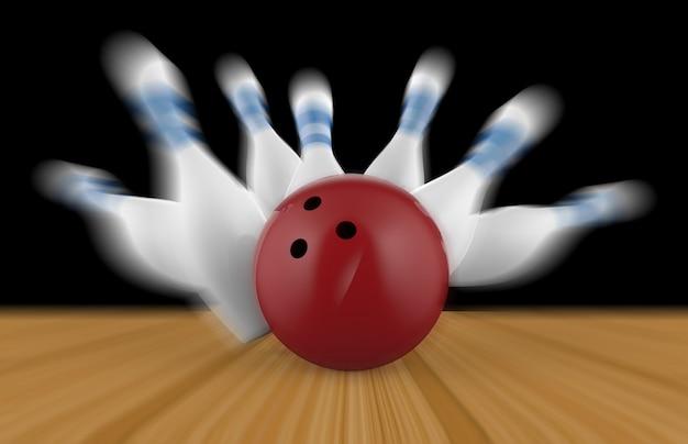 Quille dispersée et boule de bowling sur plancher en bois