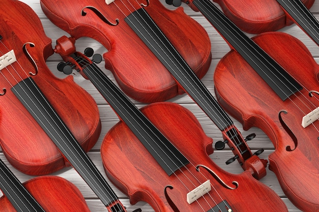 Rangées de violons en bois rouge vintage sur un fond de table en bois. rendu 3d