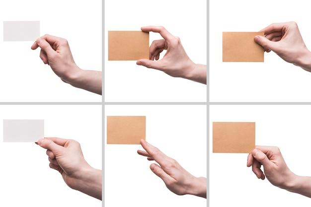 Recadrer les mains avec des cartes de visite