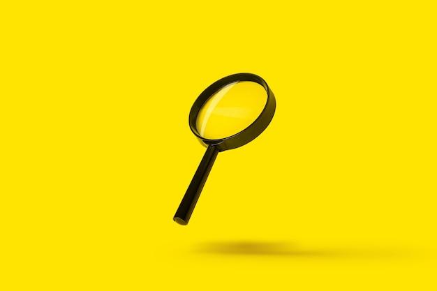 La recherche de loupe loupe loupe vole sur une surface jaune.