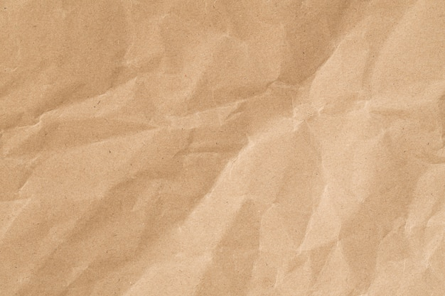 Recycler la texture froissée du papier brun, la surface du papier ancien pour le fond