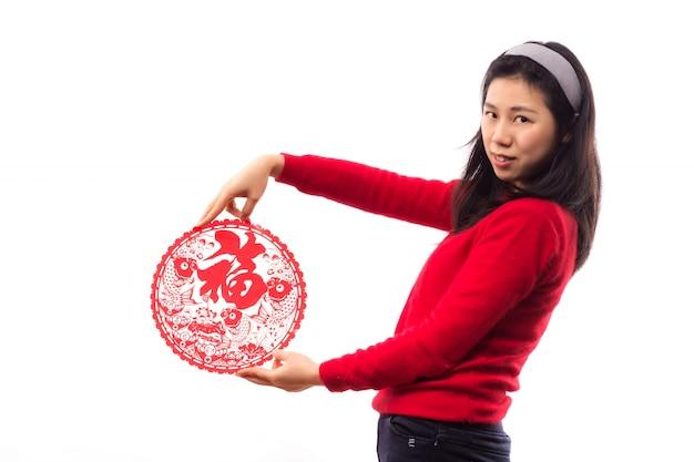 Regardant célébrer l'année dame asiatique