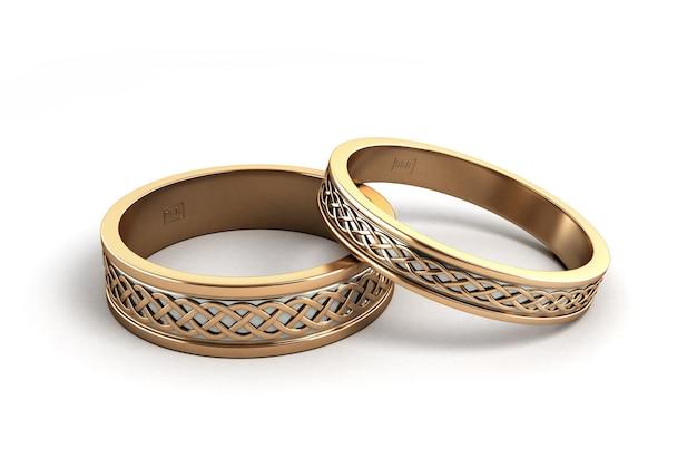 Rendu 3d des anneaux de mariage or gravé isolé sur blanc