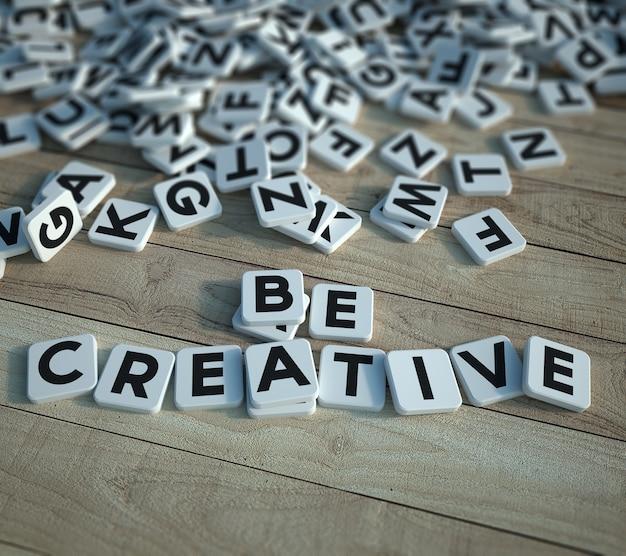 Rendu 3d d'un arrière-plan avec des carreaux de lettre dispersés avec un petit groupe formant les mots soyez créatif