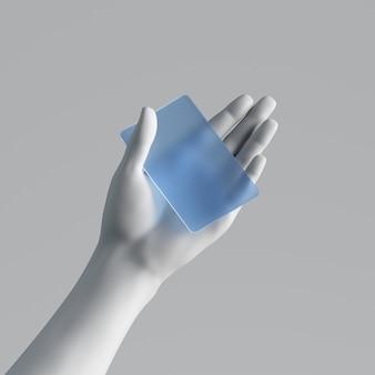 Rendu 3d, main de mannequin tenant une carte en plastique bleu vierge ou un billet de passe isolé sur fond blanc.