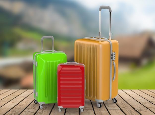 Rendu 3d trois valises rigides avec fond de paysage