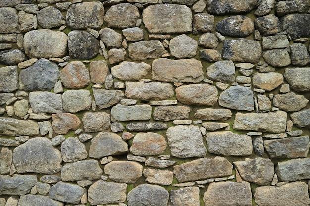 Restes d'un ancien mur de pierre inca à machu picchu, région de cuzco, pérou