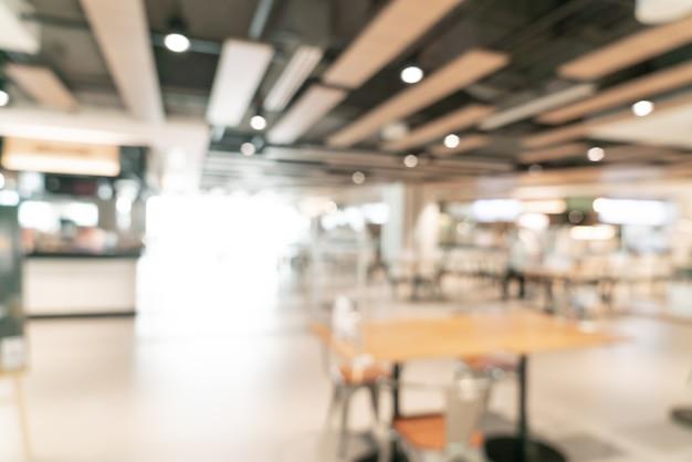 Résumé de l'aire de restauration flou dans le centre commercial pour le fond