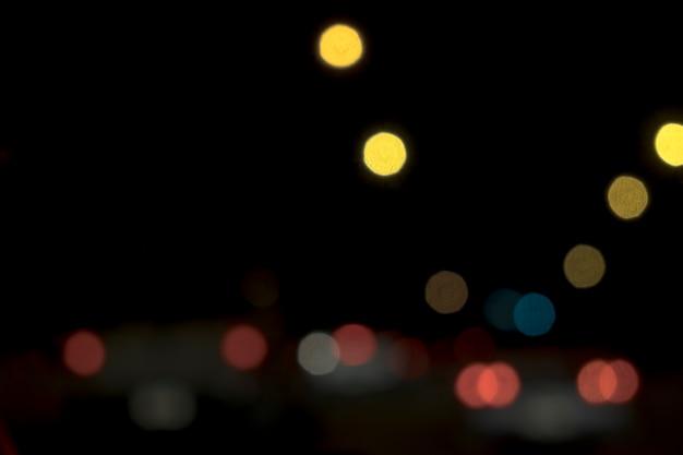 Résumé bokeh flou lumières nuit dans l'arrière-plan de la ville de la rue.