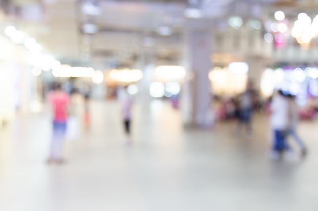 Résumé centre commercial floue du grand magasin avec fond de gens