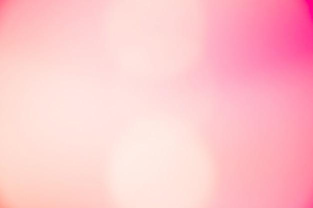 Résumé flou bokeh fond dégradé rose pâle couleur pastel doux.