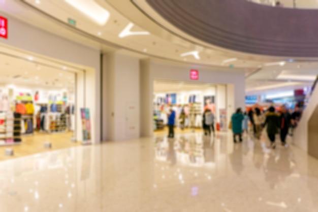 Résumé flou centre commercial de l'intérieur du magasin pour le fond