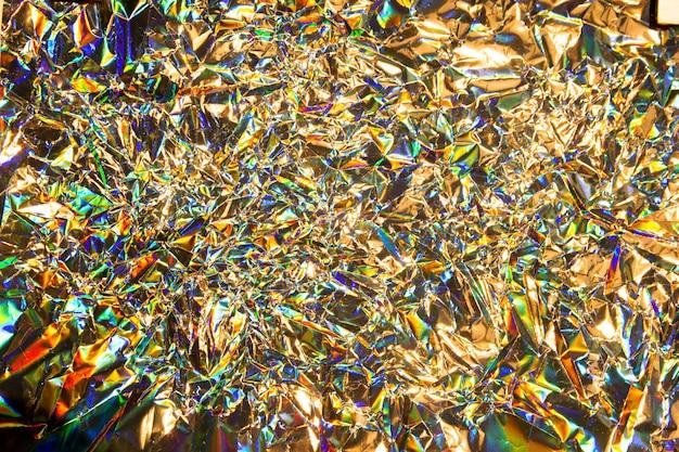 Résumé flou fond de texture de feuille de sirène irisée holographique. couleurs argentées tendance néon futuristes