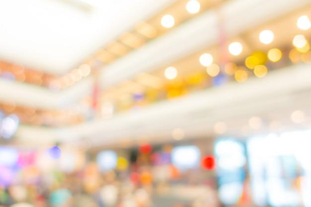 Résumé flou des gens dans le centre commercial.