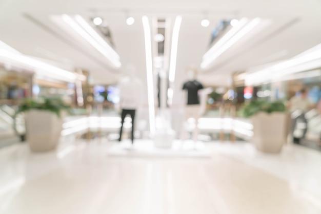 Résumé flou magasin de détail dans le centre commercial de luxe
