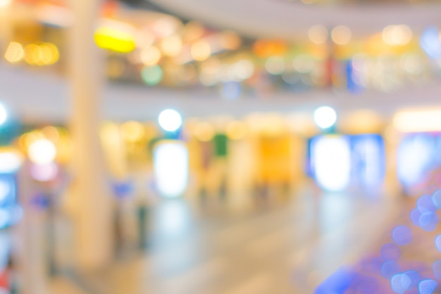 Résumé flou personnes dans un centre commercial