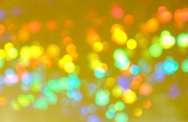 Résumé floue des lumières de l'ampoule de brillance scintillante colorée
