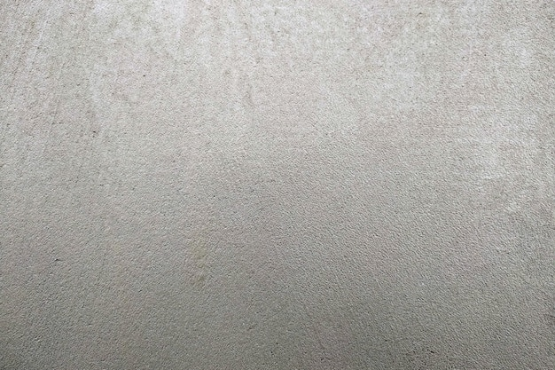 Résumé fond texturé gris. mur recouvert de mortier de ciment.