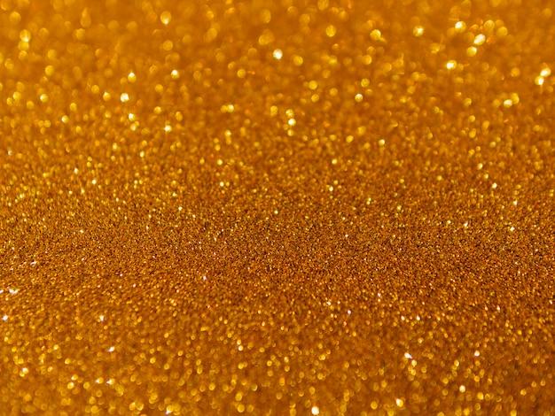 Résumé de fond de texture pailletée d'or