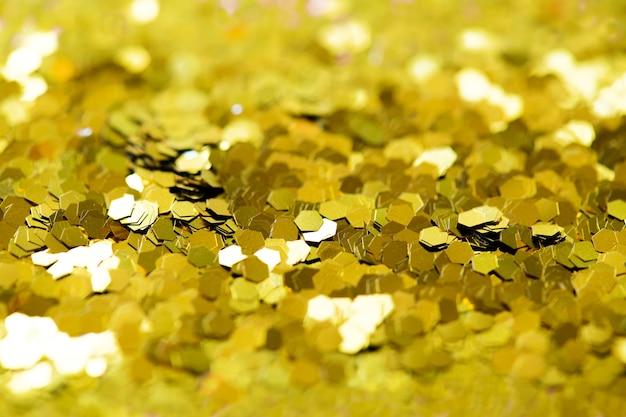 Résumé de fond texturé de paillettes d'or