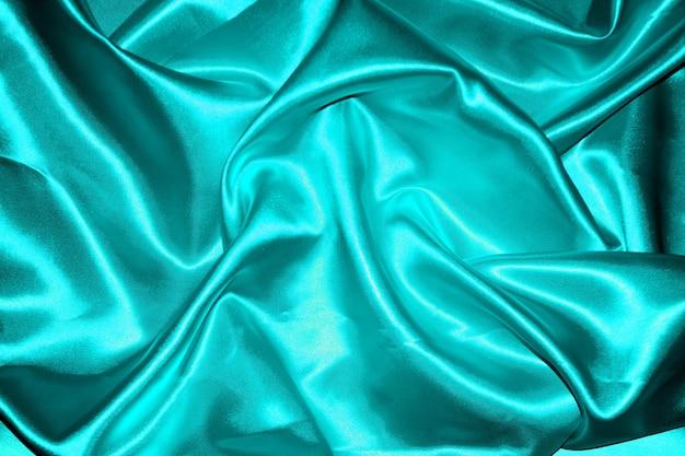 Résumé de fond de tissu bleu avec des vagues douces