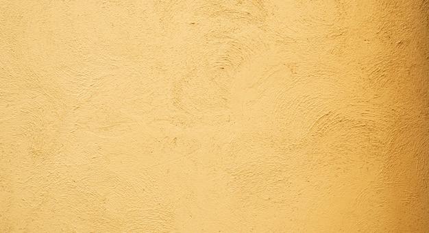 Résumé historique du mur de béton de stuc avec la lumière du soleil, la lumière et l'ombre