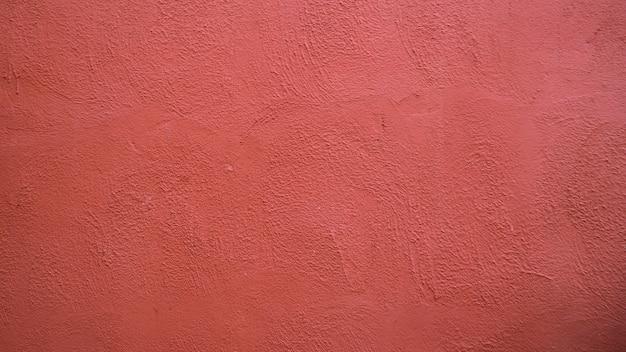 Résumé historique du mur de béton de stuc rouge avec la lumière du soleil, la lumière et l'ombre